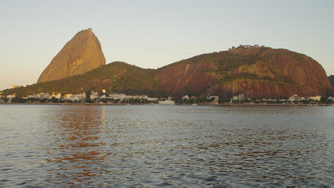 Pan across Guanabara Bay in Rio de Janeiro with mountains in the distance Footage
