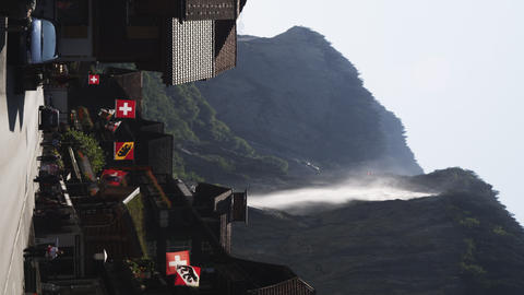 Static wide shot of Swiss town with waterfall Footage