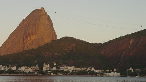 Pan of Sugarloaf Mountain with cable cars asending and descending Footage