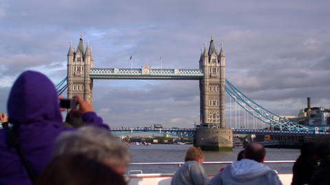 LONDON - OCTOBER 11: Unidentified tourists on ship take pictures of Tower Bridge Footage