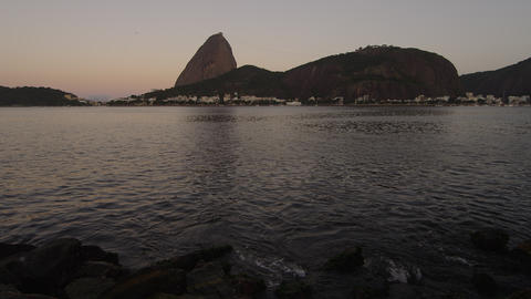Static shot of an evening view of the Rio coastline with Sugarloaf Mountain Footage