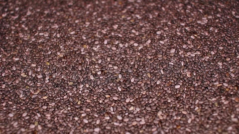 Chia seeds seed healthy food closeup texture video on rolling rotating looping Live Action