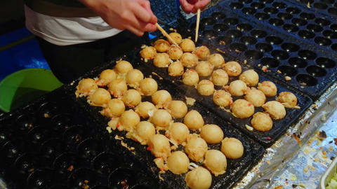 Baking dumplings on a traditional Japanese street food festival Footage