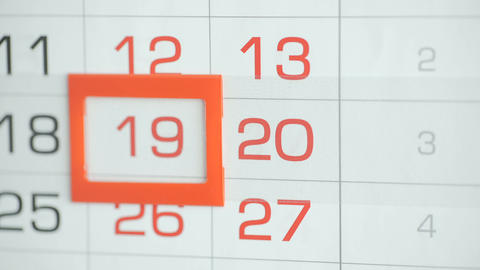 Woman's hand in office changes date at wall calendar. Changes 19 to 20 Footage