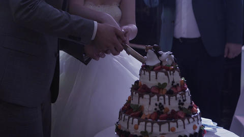 Wedding cake of a gay couple during the wedding party while photographers Footage