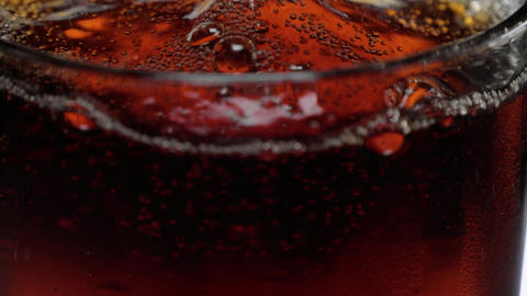 Refreshing Cola with ice cubes - close up slow motion shot Live Action