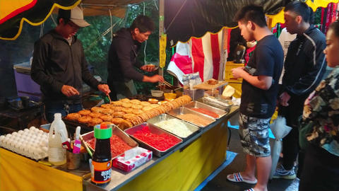 Preparation and street food sale of Japanese specialties - TOKYO, JAPAN - JUNE Live Action
