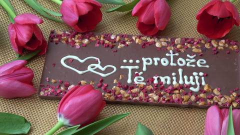 Gourmet chocolates and red tulips for Valentine's Day Footage