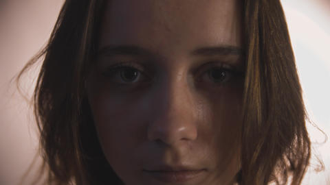 Face of young adult woman in shade Focus on eyes Footage