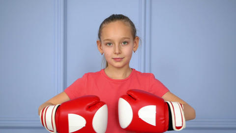 Cute little girl in boxing gloves Live Action