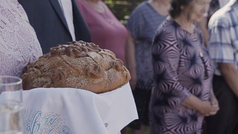 Fresh bread with salt inside holds a woman Footage