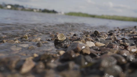 Closeup of a stony beach at evening Footage