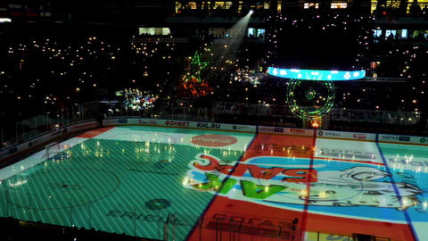 light show with different holographic figures on stadium GIF