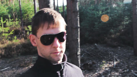 Young man walk in forest, self filming Footage