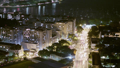 Aerial time lapse overlooking a busy street and cityscape in Rio de Janeiro, Bra Footage