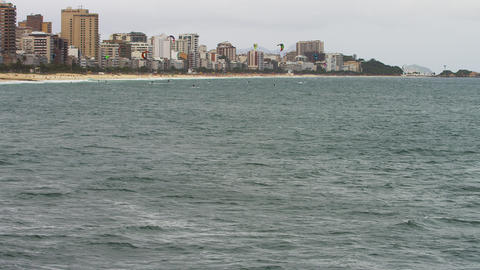 Wide shot of open ocean and surfers with City Footage