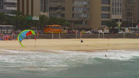 Panning shot of parasailing surfing on Copacabana beach Footage
