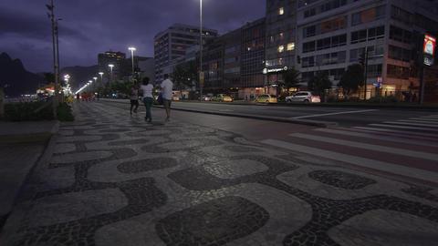 Panning shot of bus stop and Copacabana sidewalk pattern Footage