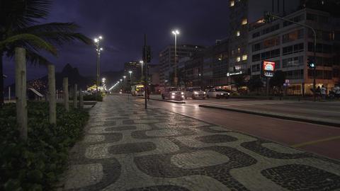 Artistic sidewalk pattern and night shot in Copacabana Footage