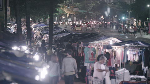 Slow panning shot of busy street vendors in Copacabana Footage
