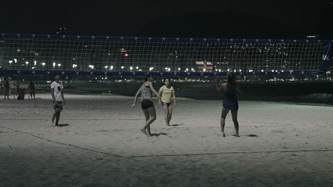 Static shot from corner of volleyball game on beach Footage