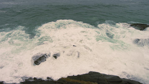 Slow motion shot of crashing waves at the coastline in Rio de Janeiro, Brazil Footage