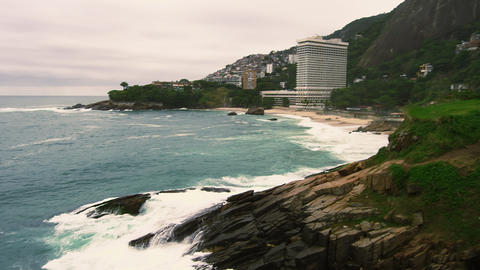 Slow motion tilting shot of Sugarloaf Mountain and the coastline at Rio de Janei Live Action