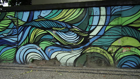 Slow motion dolly shot of artwork on perimeter wall of building in Rio de Janeir Footage