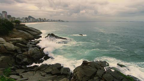 Slow motion static shot along rocky coastline of Rio de Janeiro, Brazil Footage