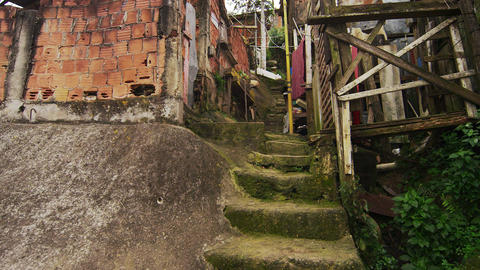 Slow motion shot of shanties and a walking man at a favela in Rio de Janeiro, Br Footage