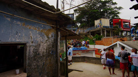 RIO DE JANEIRO, BRAZIL - JUNE 23: Tracking shot of people at favela on June 23,  Footage