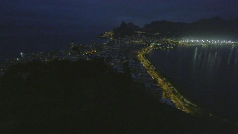 Pan of lagoon at night in Rio de Janeiro, Brazil Live Action
