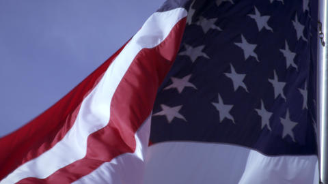 View of American flag close up and flowing in the breeze Footage