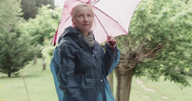 Woman with umbrella walks in the rain Footage