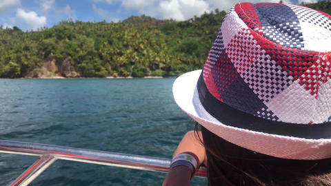 The girl looks from a boat on the peninsula Samana in the Dominican Republic Live Action