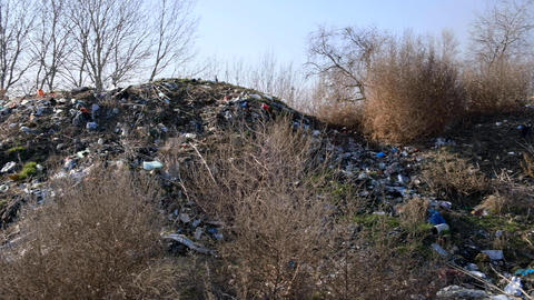 big pile of rubbish in the middle of natural nature, concept of environmental pollution Live Action