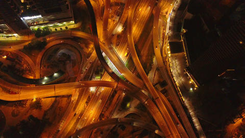 Aerial view of highway junctions at night. Bridges, roads, or streets in transportation concept. Footage