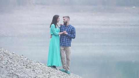 young fashionable family young man with a beard and a woman in a long dress Live Action