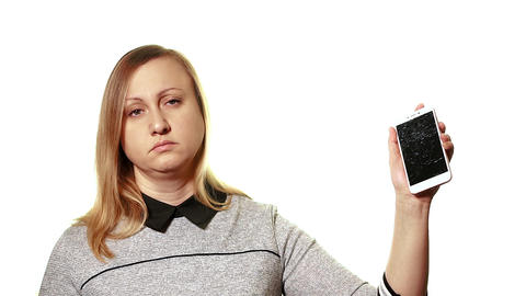 The concept of a broken gadget. Tired sleepy woman holding a smartphone with a Live Action