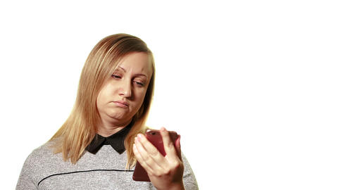 The concept of a broken gadget. Frustrated and tired woman look at your pink Live Action