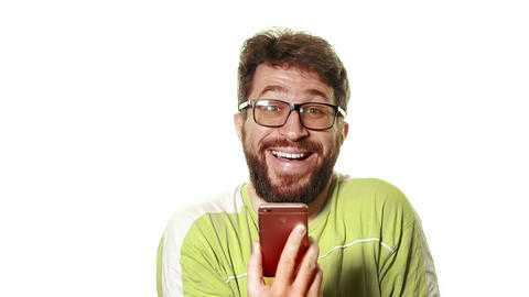 The concept of a broken gadget. Funny man with beard and glasses looking at his Live Action