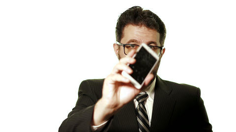The concept of a broken gadget. Bearded businessman with glasses shows a broken Live Action