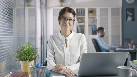 Attractive Creative Young Businesswoman in Glasses Working at day PC at office Footage