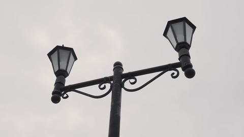Double vintage lamp on the street. Lantern street light candelabra Live Action