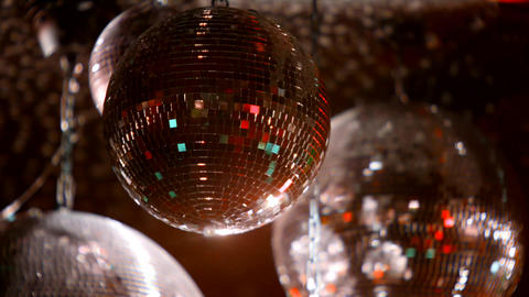 Red Mirrorballs in a club - close up shot Live Action