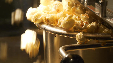 Close up shot of popcorn popping out of the pop corn machine Live Action