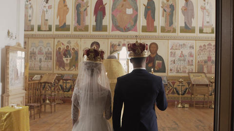 Church at the wedding. The bride and groom in the Church. Intense prayer in the Footage
