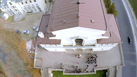 Wedding couple near the church. Aerial view Live Action
