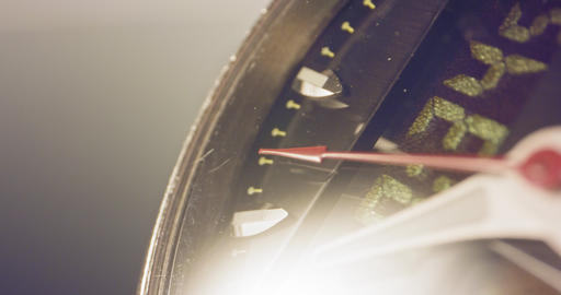 Macro footage of a hand watch with the seconds hand ticking Live Action