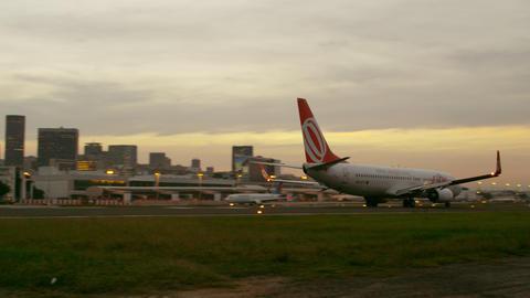 Panning shot of plane preparing for take off at the Jacarepaguá airport Footage